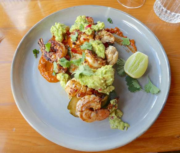 16.grilled harissa southern calamari & banana prawns with rustic guacamole, grilled summer vegetables, coriander & paprika oil