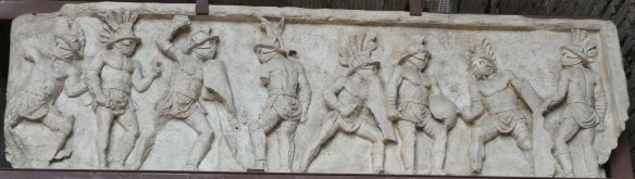 23.Bas relief in the Colosseum of gladiators fighting