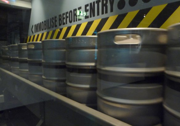 11.kegs on conveyer belt