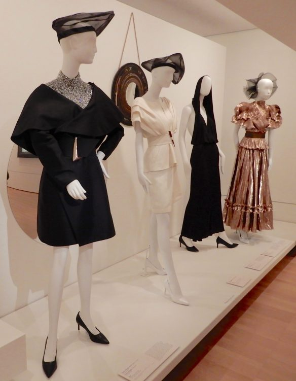 72.(L-R)Claude Montana, jacket & bodysuit 1992; Thierry Mugler, suit 1998; Alaïa, dress 1985; Zandra Rhodes, evening ensemble 1981